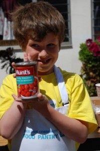 kid holding can of tomatos